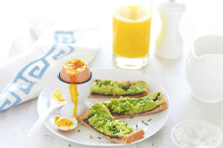 Boiled eggs with avocado soldiers
