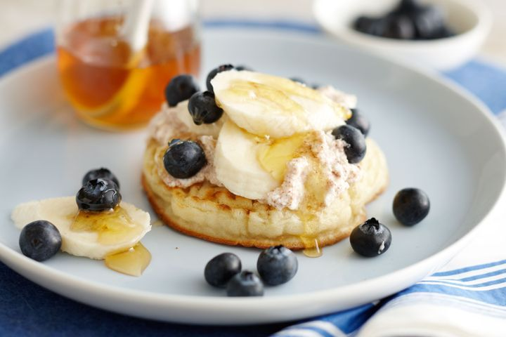 Crumpets with cinnamon ricotta, banana, blueberries and honey