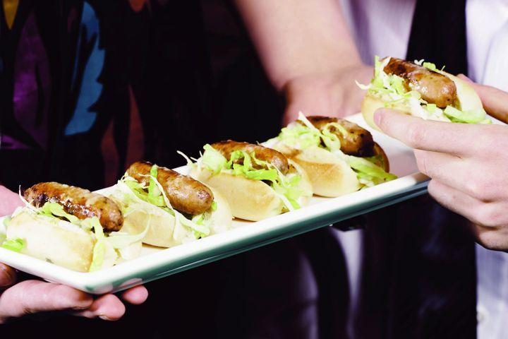 Mini hot dogs with caesar salad slaw