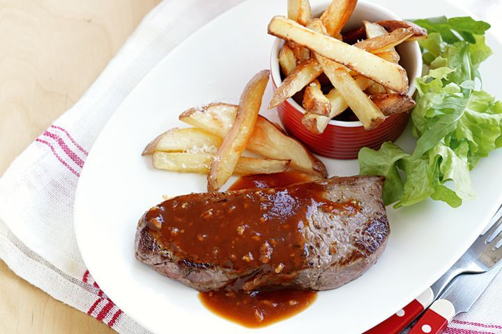 Steak and chips with garlic sauce